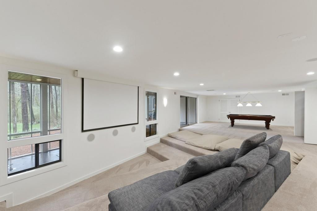 A huge space for watching movies on carpet.
