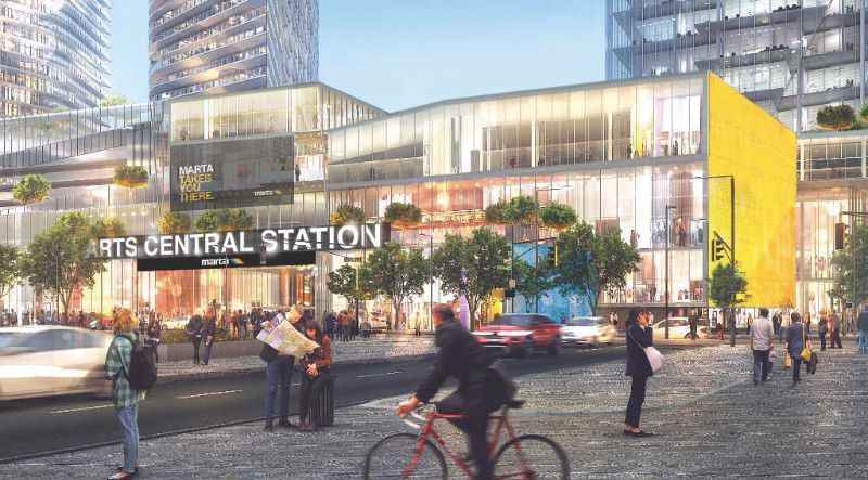 An urban development with multiple towers, above a retail podium with station access.