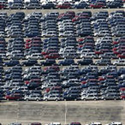 Vehicles are lined up Monday in a staging lot at the General Motors Assembly Plant in Moraine, Ohio. The plant's third shift will be eliminated next year.