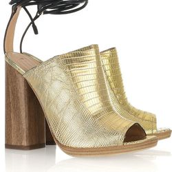 """<a href=""""http://www.theoutnet.com/product/101476"""">Reed Krakoff Metallic lizard ankle-wrap mules</a>, $131.25 (was $875)"""