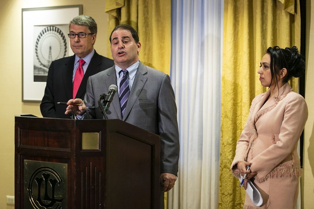 Attorneys Gregory Kulis and Gloria Schmidt look on as attorney James Tunick speaks during a press conference at the Union League Club about the filing of a federal lawsuit on behalf of Olabinjio and Abimbola Osundairo, claiming defamation in the Jussie Sm