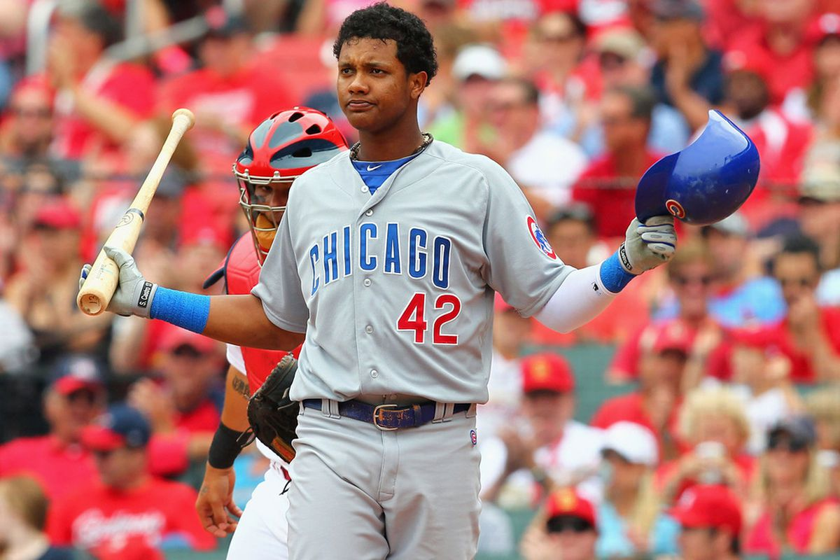 Starlin Castro of the Chicago Cubs reacts to striking out against the St. Louis Cardinals at Busch Stadium in St. Louis, Missouri.  Both teams wore the number 42 in honor of Jackie Robinson Day.  (Photo by Dilip Vishwanat/Getty Images)