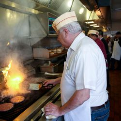 John Katzourakis works the broiler at Crown Burgers in Salt Lake City on Friday, Aug. 5, 2016. John and Rula Katzourakis have owned and operated Crown Burgers for 38 years.