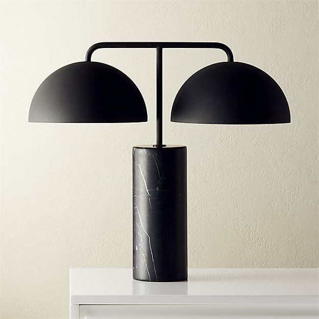 Black lamp with cylindrical base and twin half domes.