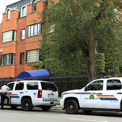 RCMP officers patrol outside the Iranian embassy in Ottawa, Friday Sept. 7, 2012. The Canadian government says it is shutting its embassy in Tehran and severing diplomatic relations amid recent attacks on foreign diplomats in Iran. Foreign Affairs Minister John Baird said Friday that the Canadian embassy in Tehran will close immediately and Iranian diplomats in Canada have been given five days to leave. He says he's worried about the safety of diplomats in Tehran following recent attacks on the British embassy there. He's also warning Canadians to avoid traveling to Iran.