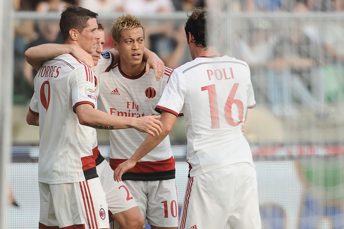 Honda celebrating with Poli, Abate and Torres after the goal