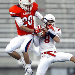 East's #8 Jason Cook ,right, makes an interception against Timpview's #20 Rickey Shumway as East and Timpview play Thursday, Nov. 10, 2011 in the 4A semifinal game at Rice Eccles stadium in Salt Lake City.