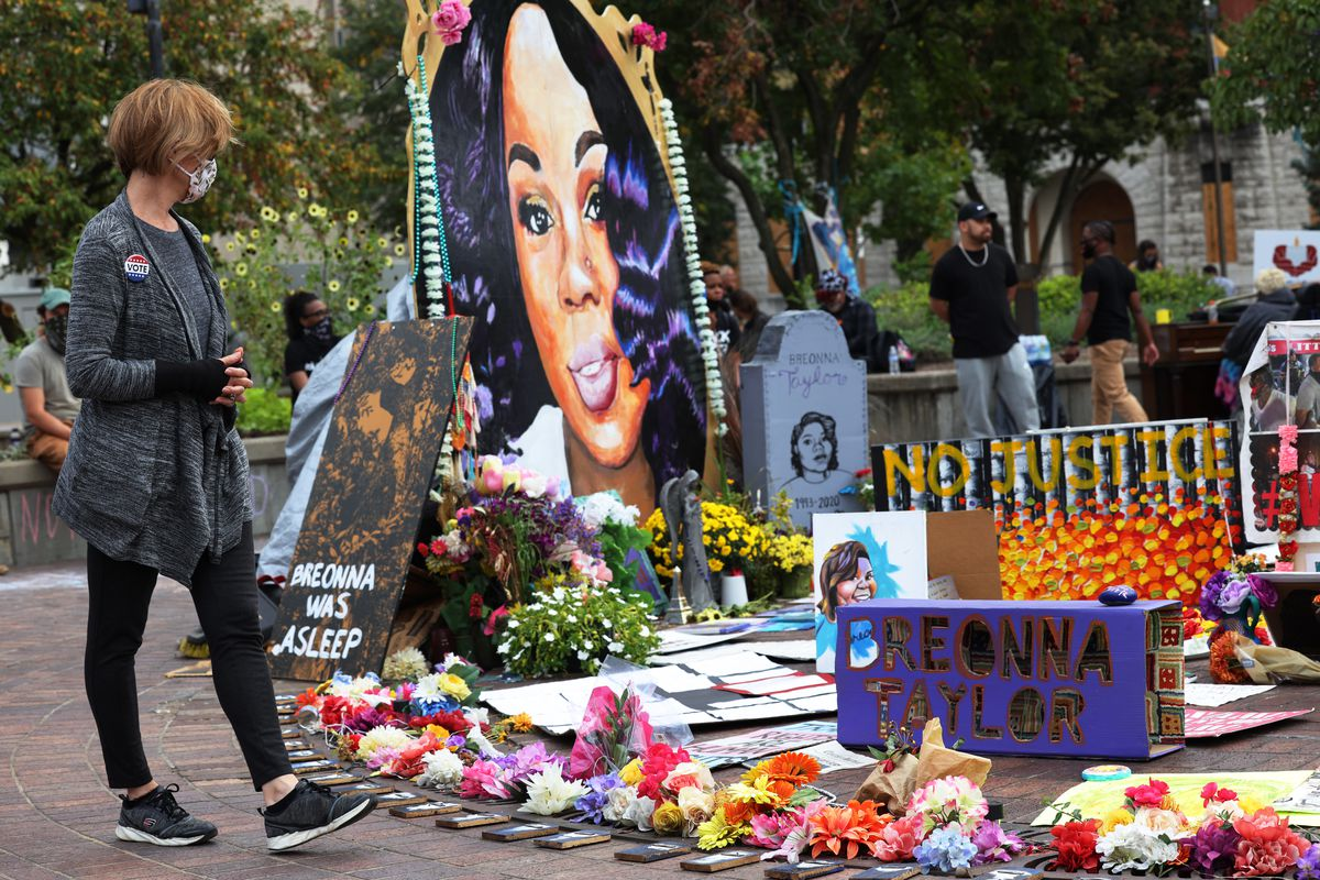 A woman stops at the memorial for Breonna Taylor in Jefferson Square Park in September in Louisville, Kentucky.