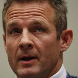 Former NFL running back Merril Hoge testifies on Capitol Hill in Washington, Wednesday, Oct. 28, 2009, before the House Judiciary Committee hearing on legal issues relating to football head injuries.