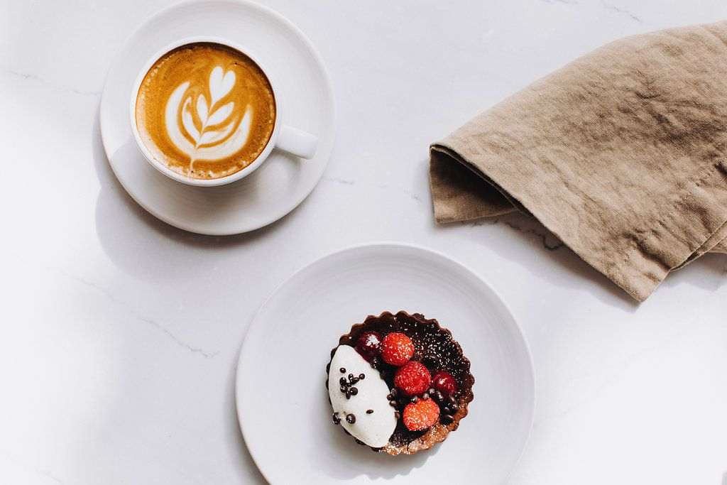 A cup of coffee and a dessert