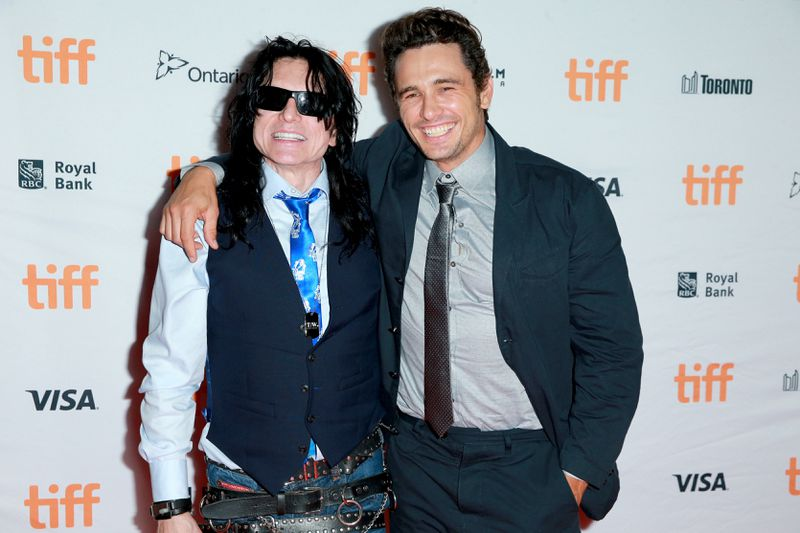 TORONTO, ON - SEPTEMBER 11:  Tommy Wiseau (L) and James Franco attend