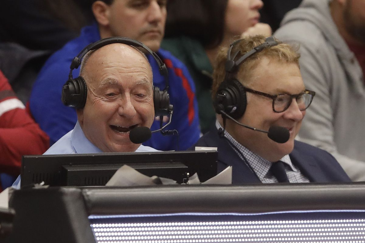 New Cubs television broadcaster Jon Sciambi, right, calls a college basketball game with Dick Vitale in 2019.