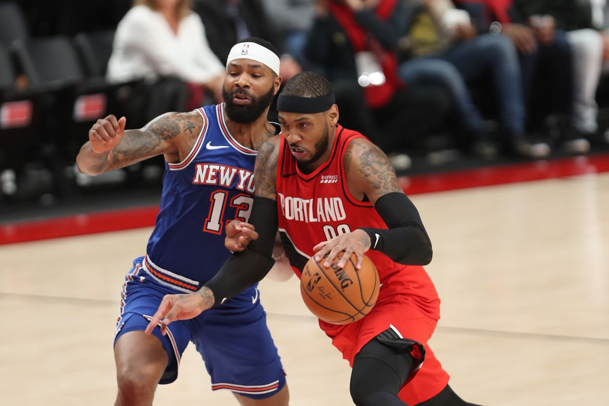 Portland Trail Blazers forward Carmelo Anthony drives to the basket against New York Knicks forward Marcus Morris Sr. in the second half at Moda Center.