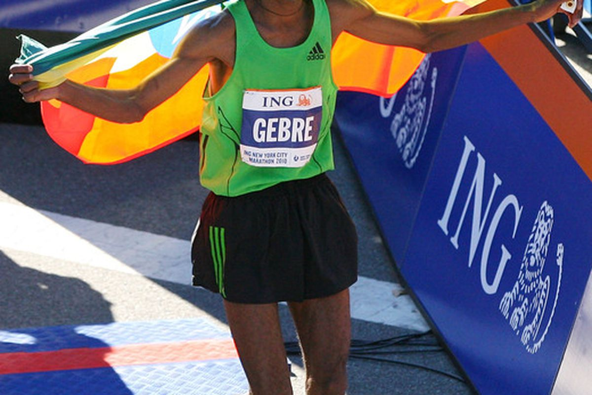 Gebre Gebremariam (14) of Ethiopia runs with the Ethiopian flag after winning the men's division of the 41st ING New York City Marathon on November 7 2010 in New York City.  (Photo by Andrew Burton/Getty Images)
