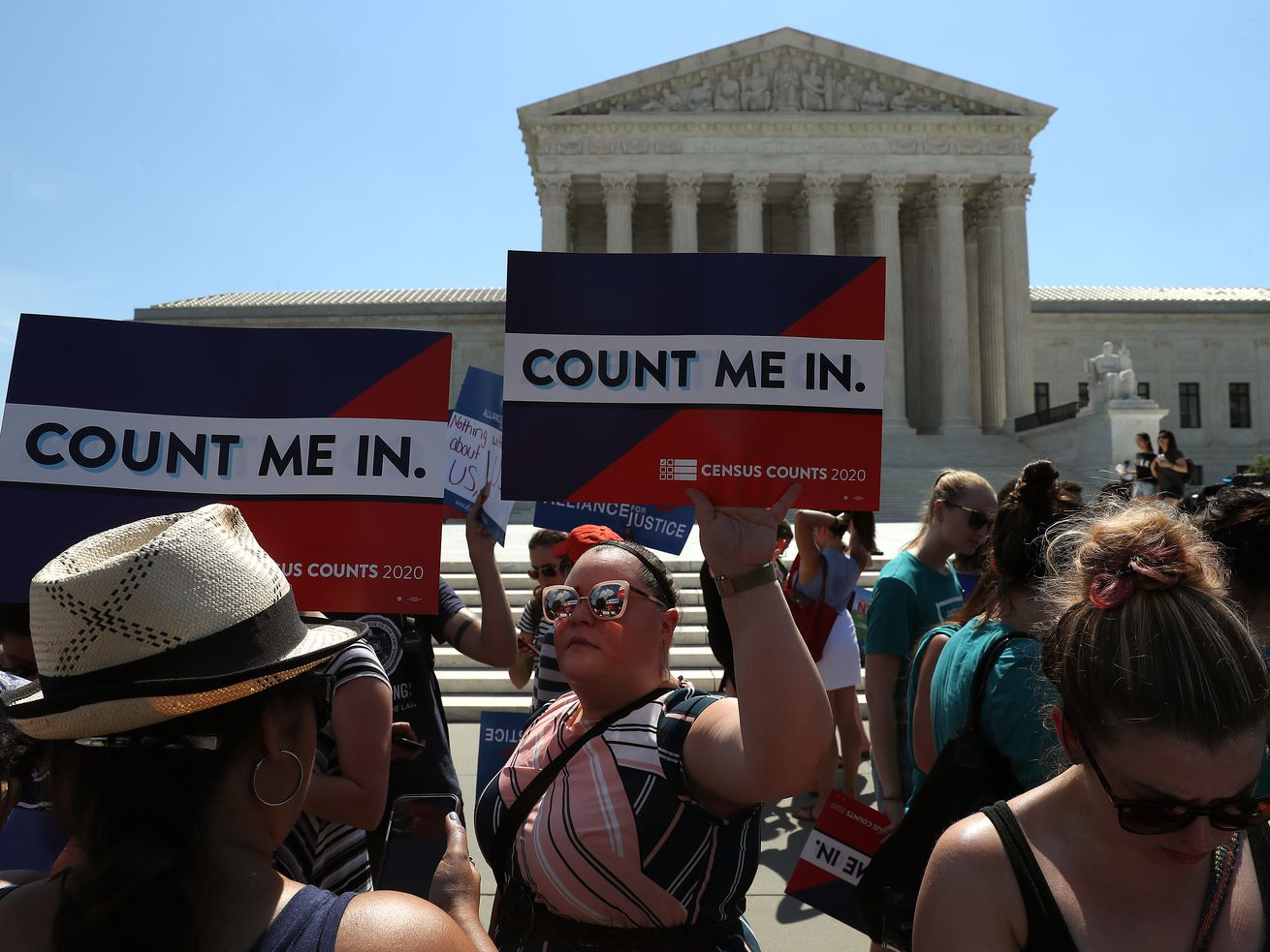 People gather in front of the US Supreme Court as decisions are handed down on June 27, 2019, in Washington, DC.