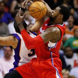 Los Angeles Clippers' DeAndre Jordan, right, pulls the rebound away from Phoenix Suns' Jared Dudley during the first half of an NBA basketball game, Thursday, April 19, 2012, in Phoenix.
