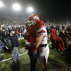Utah defensive tackle Dave Kruger gets a hug from a Utah fan after his team lost to BYU 26-23 at LaVell Edwards Stadium in Provo Saturday.