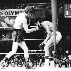 """Featherweight champion Danny """"Little Red"""" Lopez delivers a punch to Brazilian challenger Jose DePaula during their fight in 1978 in Los Angeles. Lopez knocked out DePaula in the sixth round to retain his championship. Although Lopez, now 57, will be inducted into the Hall of Fame June 13, he works a construction job to support his family financially."""