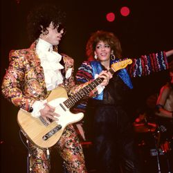 Performing with Sheila E at the Ritz Club on his Purple Rain Tour.