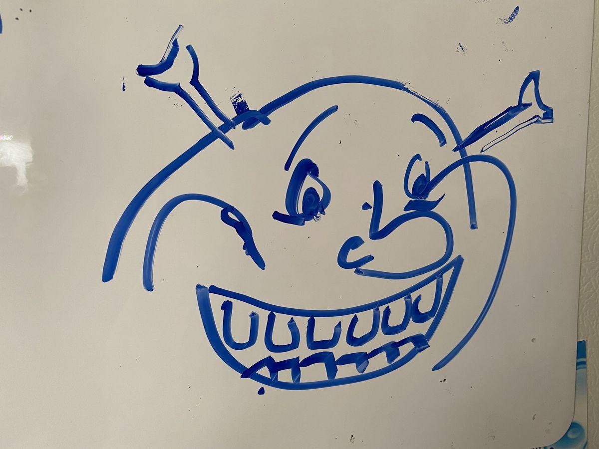 a whiteboard drawing of shrek