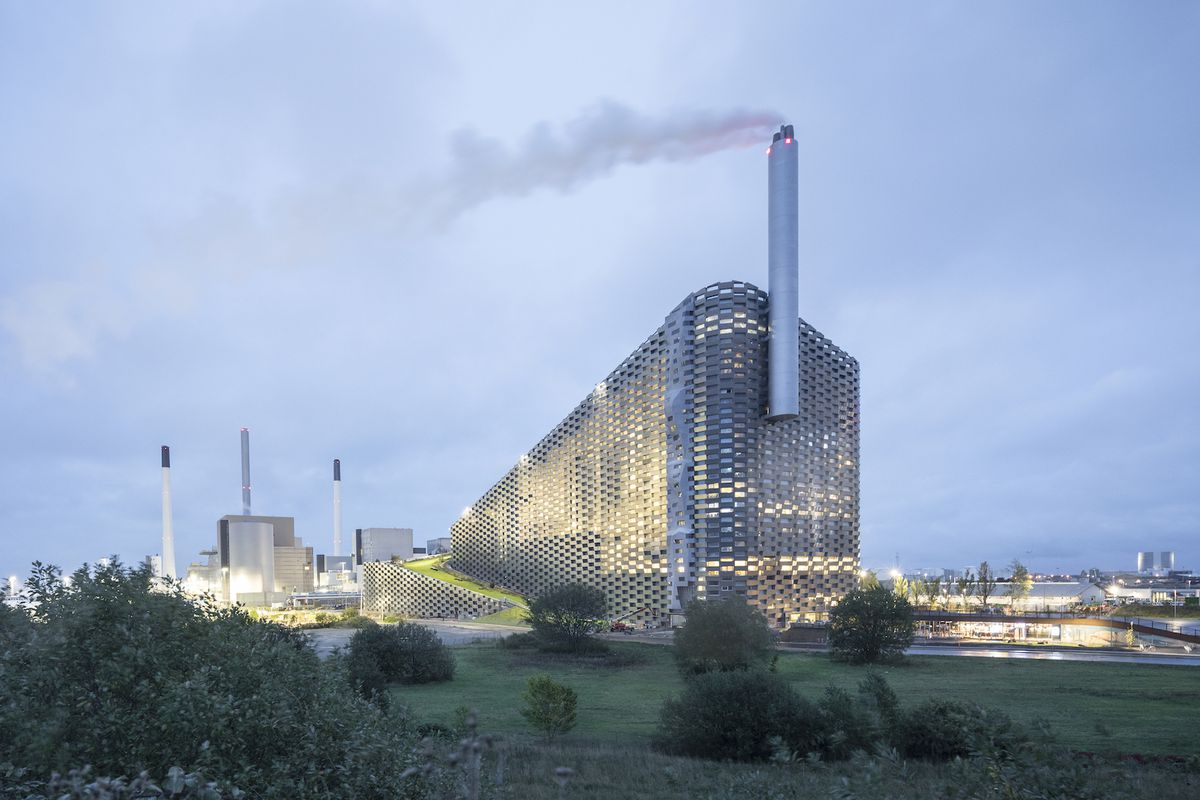 Sloped power plant clad in metal at twilight.