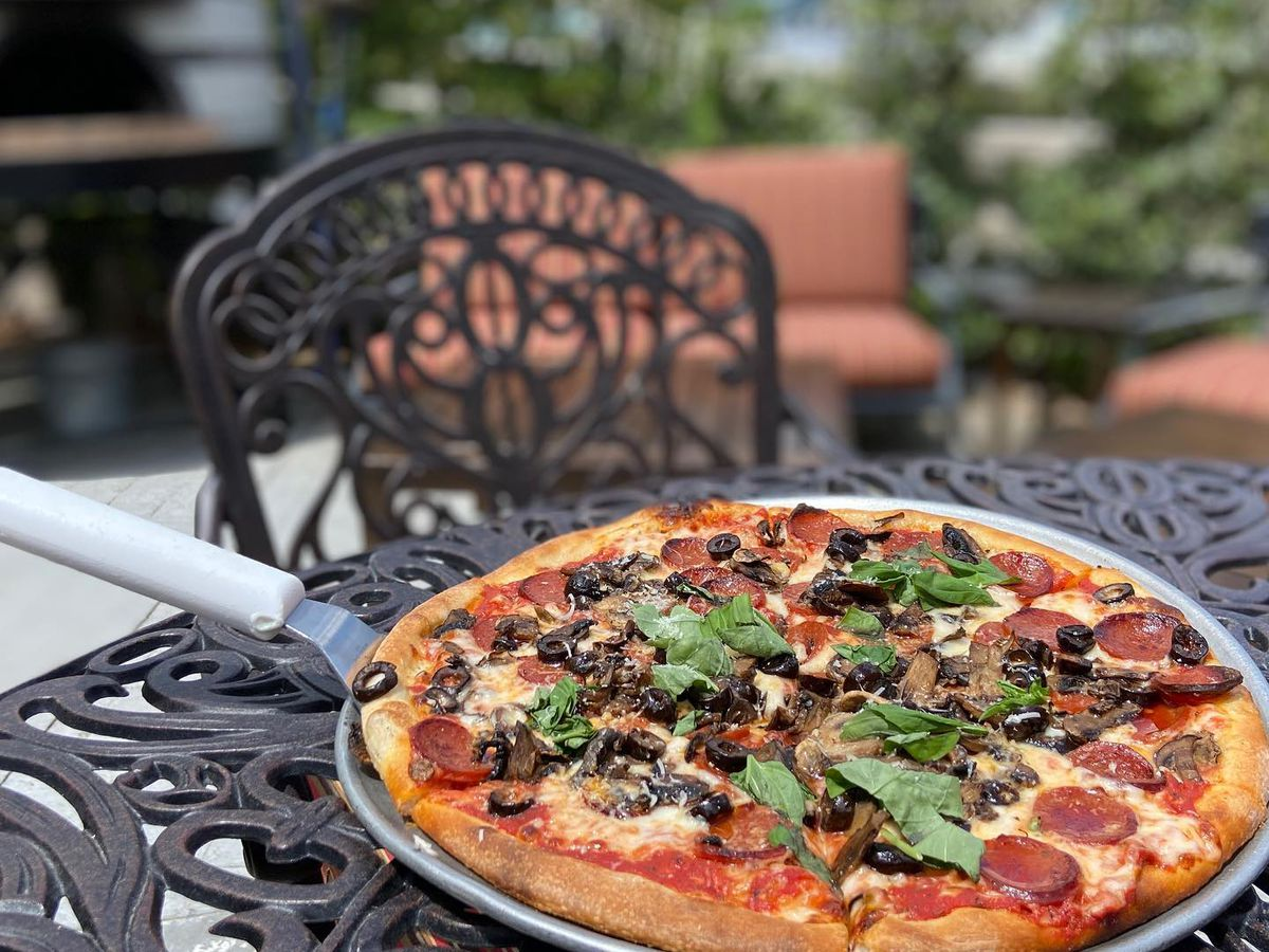 A pizza on a patio