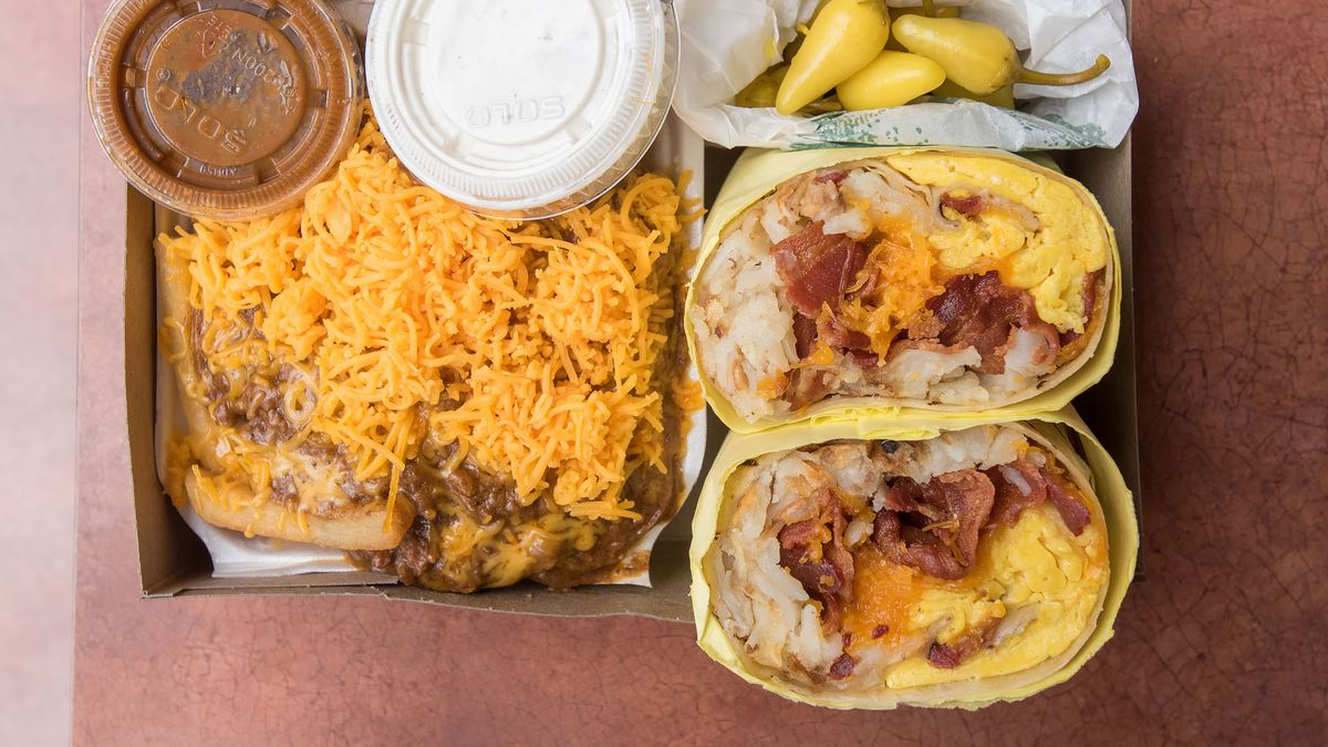 Breakfast Burrito at Lucky Boy, served in a cardboard box next to chili cheese fries.
