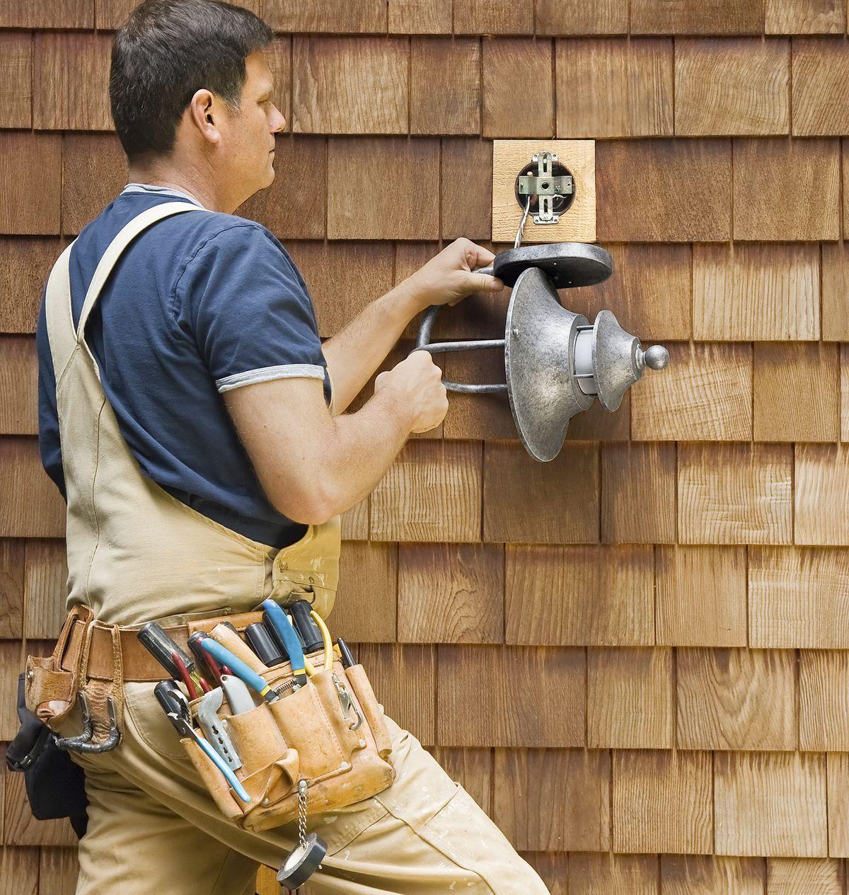 Electrician Installing Porch Light Fixture