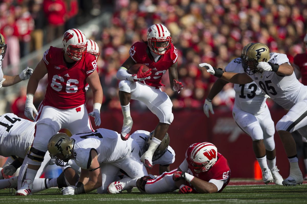 Dare Ogunbowale leaping over the pile in Wisconsin's win over Purdue on Saturday.