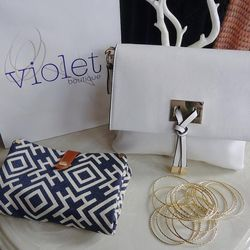 Keep walking up 18th and get back to this decade at Violet Boutique (2439 18th Street NW), where owner Julie Egermayer offers girly, on-trend styles from midi-rings to statement necklaces to cocktail dresses. Best of all, the prices are easy on the wallet