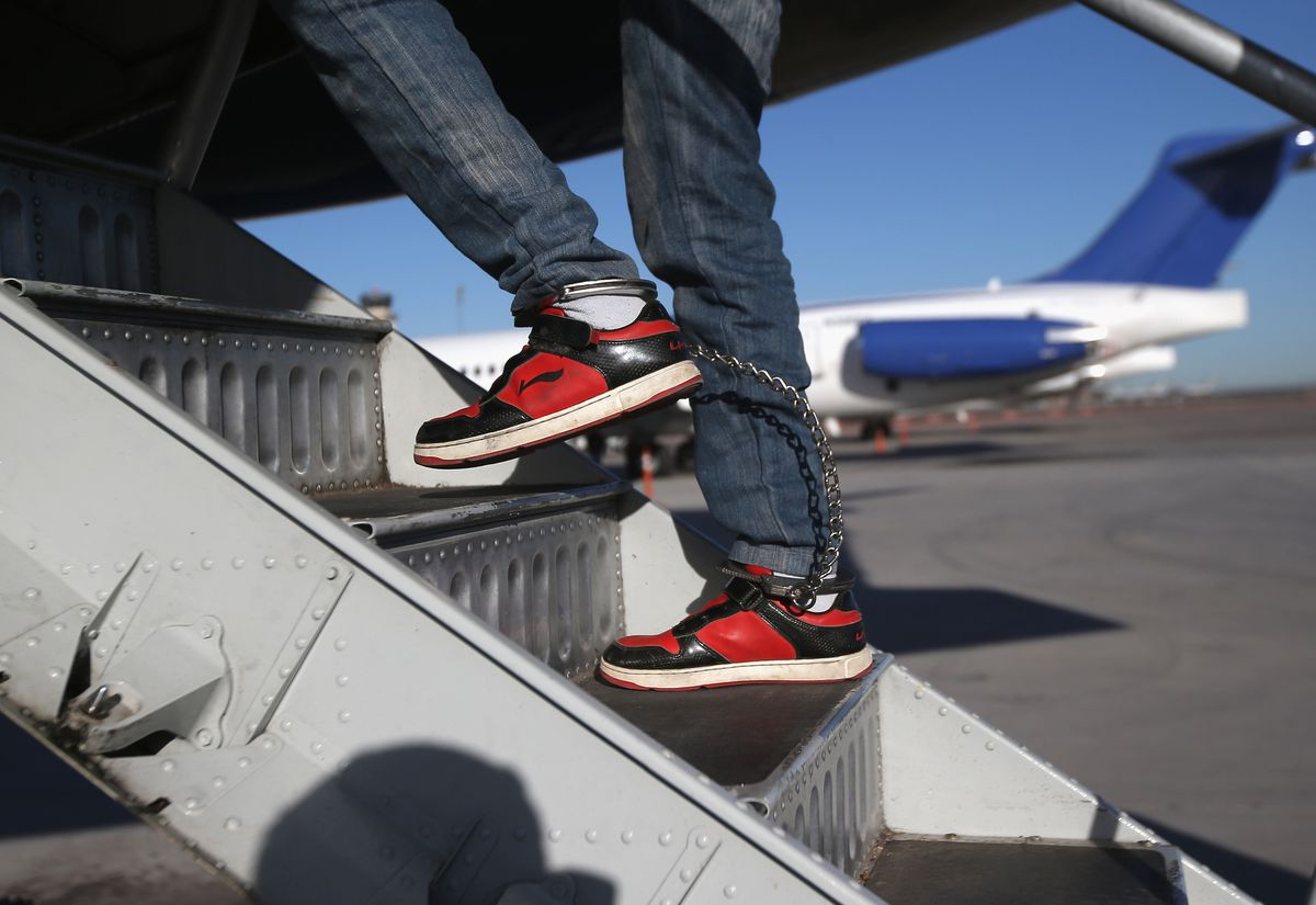 Immigrant shoes boarding plane