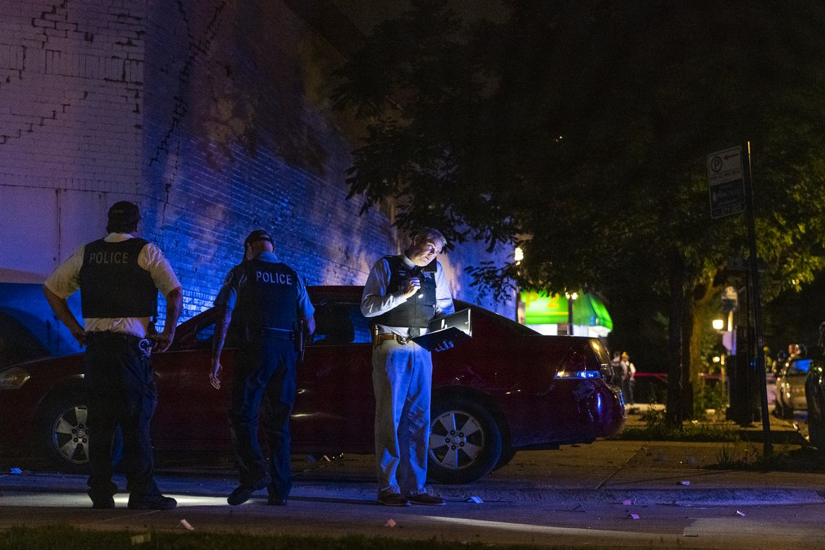 Chicago police work the scene where at least eight people were shot in the 6300 block of South Artesian Avenue in the Marquette Park neighborhood on Sunday, June 27, 2021.