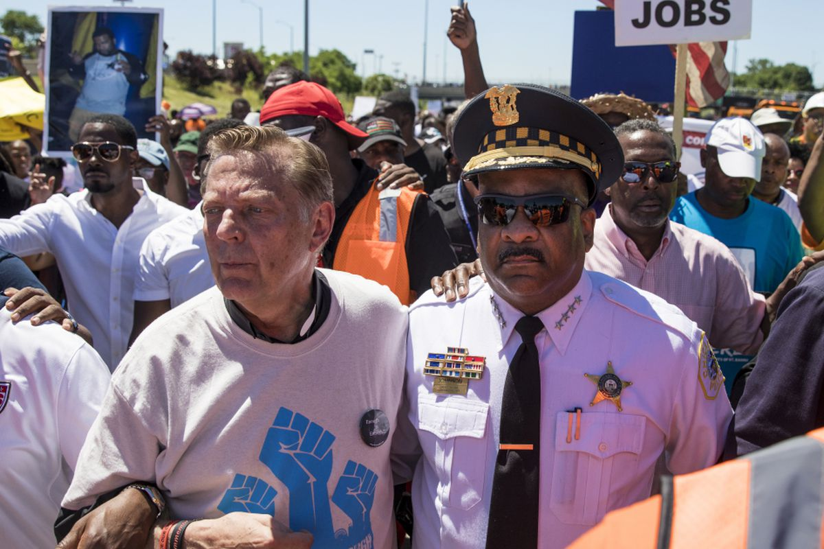 Father Michael Pfleger and Chicago Police Supt. Eddie Johnson march arm-in-arm alongside thousands of anti-violence protesters who poured into the inbound lanes of the Dan Ryan Expressway on Saturday morning, July 7, 2018.