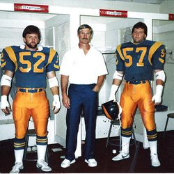 Fred Whittingham, center, is flanked by his sons, Kyle and Cary, in 1987 in the locker room of the Los Angeles Rams.