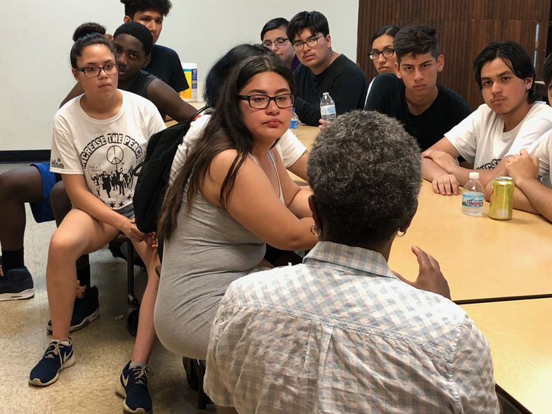 Mayor Lori Lightfoot chats with about a dozen youths, seeking their perspective on why young adults pick up guns or become shooters.