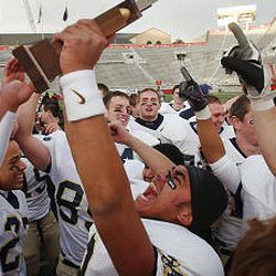Skyline's football team celebrates its win over Brighton at Rice-Eccles Stadium for the 5A state championship. The Eagles have won 14 titles.