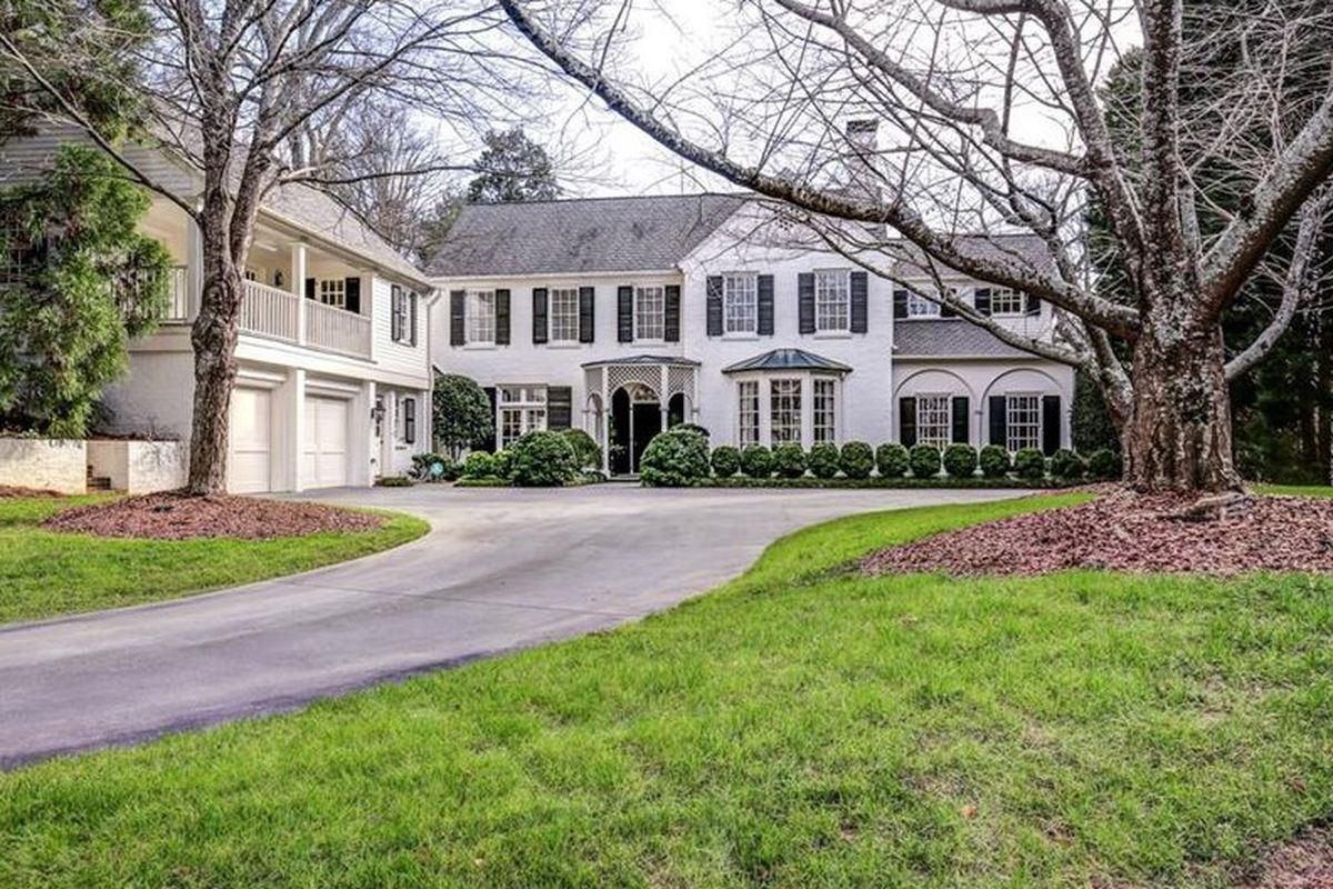 Driveway leads to front entrance of home.