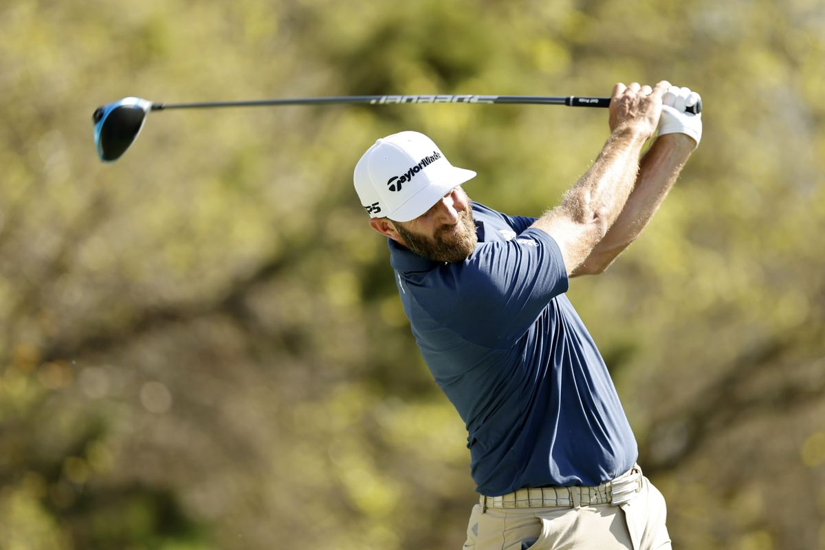 Dustin Johnson of the United States plays his shot on the 18th tee in his match against Kevin Na of the United States during the third round of the World Golf Championships-Dell Technologies Match Play at Austin Country Club on March 26, 2021 in Austin, Texas.
