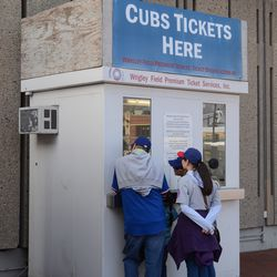 5:07 p.m. Customers at the Wrigley Field Premium Tickets booth outside the ballpark -