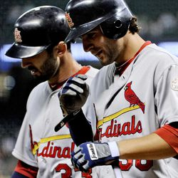 St. Louis Cardinals' Pete Kozma, right, and Daniel Descalso (33) head to the dugout after scoring on Kozma's two-run home run against the Houston Astros in the second inning of a baseball game, Monday, Sept. 24, 2012, in Houston.