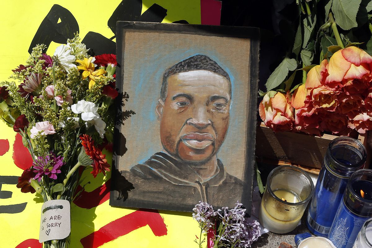 A portrait of George Floyd is part of the memorial for him near the site where he was arrested in Minneapolis. He died in police custody Monday night. A video shared online by a bystander showed a white officer kneeling on his neck during his arrest as he pleaded that he couldn't breathe.