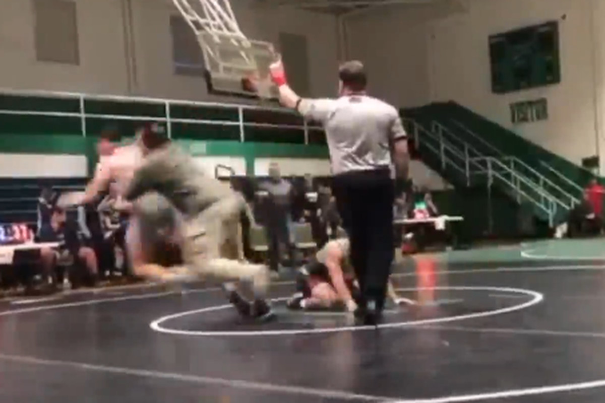 KANNAPOLIS, N.C. — A father was arrested and is charged with simple assault after he rushed and tackled a high school student-athlete during a wrestling match, according to a Kannapolis Police Department news release.