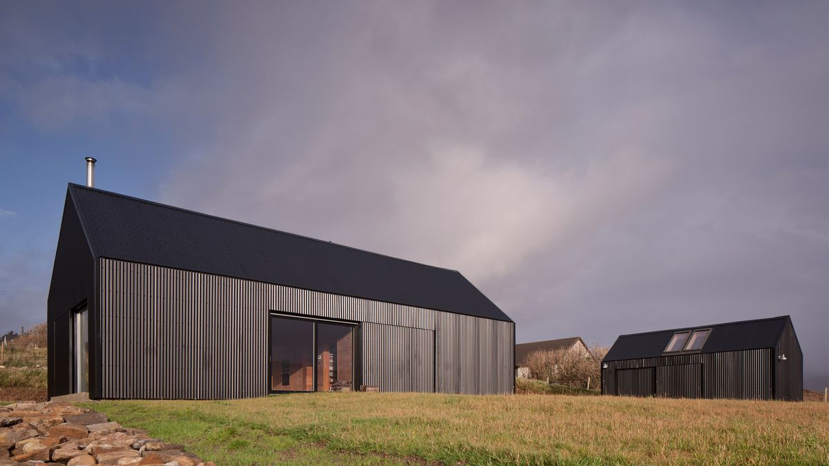 Black-clad house in countryside