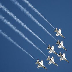 The Air Force's Thunderbrds perform as thousands turn out for the Hill Air Force Base air show  Saturday.