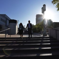 Conferencegoers walk near the Conference Center in Salt Lake City during the 191st General Conference of The Church of Jesus Christ of Latter-day Saints on Saturday, Oct. 2, 2021.