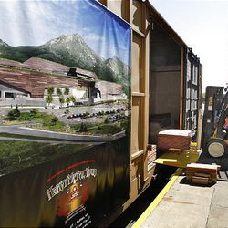 Copper is loaded Wednesday on a train car that will travel to Buffalo, N.Y., for fabrication and then come back here to be used in the Utah Museum of Natural History's new building, the Rio Tinto Center, where the copper will be used to wrap the building.