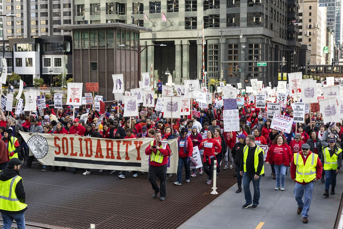 Thousands of Chicago Teachers Union members and their supporters march through the Loop on day two of the teachers' strike.