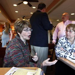 Delegates Kristen Price, left, and Connie Marston discuss congressional candidates at IHOP in West Jordan last week.