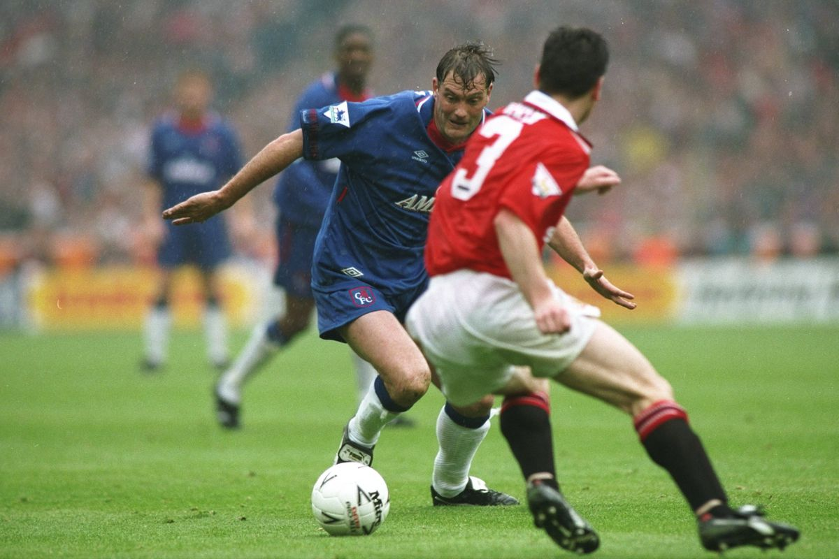 Denis Irwin of Manchester United and Glen Hoddle of Chelsea