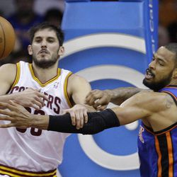Cleveland Cavaliers' Omri Casspi (36), from Israel, and New York Knicks' Tyson Chandler (6) battle for a loose ball in the second quarter in an NBA basketball game on Friday, April 20, 2012, in Cleveland.